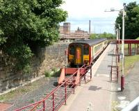 Glasgow Central service waiting at Paisley Canal in July 2005. Looking east from the steps up to the road bridge.<br><br>[John Furnevel&nbsp;29/07/2005]