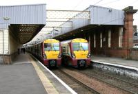 Platforms 1 and 2 at Paisley Gilmour Street, looking west in July 2005, with class 334s destined for Wemyss Bay (left) and Glasgow Central ready to depart.<br><br>[John Furnevel&nbsp;30/07/2005]