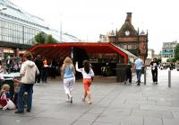 The new 'modern' entrance to St Enoch Subway on a Saturday in July 2005 with the original 1896 building standing directly behind. To the left is the St Enoch Centre, built on the site of the great main line station which closed in 1966. [See image 50452]<br><br>[John Furnevel&nbsp;02/07/2005]
