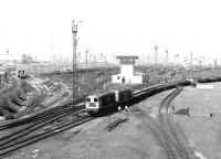 Looking north west at Tinsley Yard in May 1980 showing 20131+20057 passing through with a train of steel flats. Note the catenary on the far left used by electrically hauled trains off the ex-GC Woodhead route, at that time just over two months from closure.<br><br>[John Furnevel&nbsp;06/05/1980]