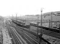 View south east at Tinsley in May 1980 with 41A MPD in its elevated position top right. The depot opened in 1964 when it took over activities previously undertaken at Grimesthorpe, Darnall, Canklow and Millhouses. At its peak it had an allocation of over 200 locomotives. [See image 42626]<br><br>[John Furnevel&nbsp;06/05/1980]