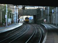 A class 66 heading north 'light engine' on the WCML through the dark cavern of Motherwell station in February 2006.<br><br>[John Furnevel&nbsp;25/02/2006]