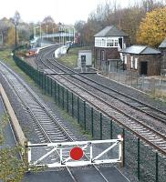 Looking north west towards Shildon station from Spout Lane road bridge in November 2004. The fence marks the boundary of the NRM site, with access to the yard and main exhibition hall via the gate on the left.<br><br>[John Furnevel&nbsp;02/11/2004]