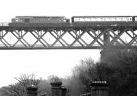 Edinburgh - Aberdeen train above the rooftops of South Queensferry in 1982 on the approach to the Forth Bridge.<br><br>[John Furnevel&nbsp;25/10/1982]