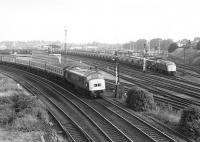 45036 on a Poole - Newcastle train passes 40085 on a PW train shortly after leaving York in 1980.<br><br>[John Furnevel&nbsp;21/07/1980]