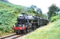 Black 5 No44767 <i>George Stephenson</i> storms up the gradient to Glenfinnan with <i>The Royal Scotsman</i> from Fort William in July 1994.<br><br>[John Gray&nbsp;/07/1994]