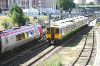 Scene at Kensington Olympia on the West London Line on 20 July 2005 as a Virgin CrossCountry Voyager arrives with a Brighton - Birmingham service. On the right, one of the Silverlink dual voltage 313 units is pulling away from the southbound platform with a Willesden Junction - Clapham Junction train.<br><br>[John Furnevel&nbsp;20/07/2005]