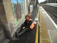 Artist Adele Conn seen here on 18 September 2011 at work on her new mural at Prestonpans station. [See news item] [See image 34627 for wide view of mural]<br><br>[John Yellowlees&nbsp;18/09/2011]