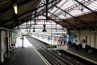 Looking out from the old trainshed along District Line platform 9 at Ealing Broadway in July 2005. This being a particularly wet day the external platforms are in use!<br><br>[John Furnevel&nbsp;20/07/2005]