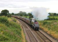 Nearing the summit at Hoghton on 18th August, no 60009 is working hard with the 12 coach outward <I>'Cumbrian Mountain Express'</I> and an idling Class 47 on the rear. The 3-cylinder beat and chime whistle of the A4 could be heard long before it appeared round the curve. <br><br>[Mark Bartlett&nbsp;18/08/2012]