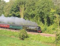 Bulleid unrebuilt 'Battle of Britain' Pacific no 34067 <I>'Tangmere'</I> passing Avoncliff Station on the Bath to Westbury line on 19 August 2012  with 'The Weymouth Seaside Express'.<br><br>[Peter Todd&nbsp;19/08/2012]