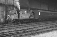 One of Gateshead shed's class J72 0-6-0Ts no 68723, specially repainted for station pilot duties at Newcastle Central, shunts a TPO in the station on 17 June 1961.<br><br>[K A Gray&nbsp;17/06/1961]