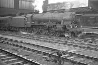 Carrying the headboard of 'The Waverley', Royal Scot no 46130 <I>The West Yorkshire Regiment</I> stands at Carlisle platform 4 ready to take out the 10.05 Edinburgh Waverley - London St Pancras on 1 July 1961. On this occasion, for reasons unknown, locomotive changeover had taken place earlier at Canal Junction.<br><br>[K A Gray&nbsp;01/07/1961]