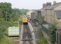 Leyburn station, seen from the overbridge looking east in August 2012, with a Wensleydale Railway DMU waiting to depart for Redmire. As the line now hosts steam as well as diesel services the redundant loop track has been lifted and watering facilities installed. [See image 1451].<br><br>[Mark Bartlett&nbsp;11/08/2012]