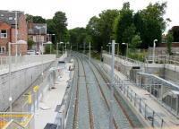 A brand new Metrolink station under construction in 2012 on the East Didsbury line that reopened the following year. Although this is a new site for a station the line itself was once the old Midland main line out of Manchester Central, which closed to all traffic in 1969. As the trackbed was protected it has been available for use on the expanding Metrolink network. View towards Chorlton (-cum-Hardy) on 17 August 2012 from what became the station entrance.<br><br>[Mark Bartlett 17/08/2012]