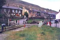 Track lifting underway at Six Bells Crossing, Blaina, between Abertillery and Brynmawr, in 1977. This section of the line, running north to the site of Coalbrookvale Iron Works, had closed 4 years earlier. <br><br>[Ian Dinmore&nbsp;//1977]