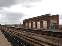 Retained section of the former overall roof support wall that ran along island platforms 2 & 3 at Wakefield Kirkgate, with new subway canopy supports in place alongside platform 2. [See image 40060]<br><br>[David Pesterfield&nbsp;26/08/2012]
