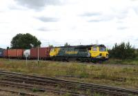 Freightliner 70009 brings a freight off the Oxford line through Didcot on 23 August 2012. <br><br>[Peter Todd 23/08/2012]