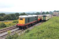 English Electric Type 1 20166 whistles away from Redmire with the first train of the day for Leeming Bar. In the background is Wensleydale and hopefully it wont be too long before railway passengers can travel further west along the valley to Aysgarth and beyond.  <br><br>[Mark Bartlett&nbsp;12/08/2012]