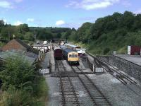 A general view of Wirksworth station from the overbridge with a 3-car DMU about to depart for the junction at Duffield. On the right is the platform serving the short 1:30 branch to Ravenstor with an elaborate trap point arrangement in place for any <I>overshoots</I>. [See image 35791]<br><br>[Malcolm Chattwood&nbsp;14/08/2012]