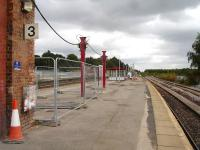 Looking east along a now lifeless platform 3 at Wakefield Kirkgate on 26 August 2012. This follows the removal of the bulk of the former overall roof support wall previously running almost the full length of the platform. The waiting shelter has been sited some distance from its final indicated position. [See image 34147]<br><br>[David Pesterfield&nbsp;26/08/2012]