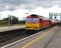 DBS 60063 runs east through Didcot station on 23 August 2012 with a train of oil tanks. <br><br>[Peter Todd 23/08/2012]