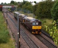 A Pair of WCRC Class 33s heading south on the WCML passed Farington on a dull and overcast 29 August 2012 with a single coach on a Carnforth to Southall working. <br><br>[John McIntyre&nbsp;29/08/2012]