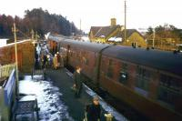 In late January and early February 1963, the Waverley Route was blocked by snow between Stobs and Steele Road stations for 18 days. This scene, featuring the 4.33 pm Carlisle-Edinburgh train, is further south at Newcastleton on Saturday 23rd February, during the subsequent 25 days of single-line operation before the line was fully re-opened between Steele Road and Stobs. One month later, the publication of the Beeching Report would effectively seal the Waverley Route's fate.<br><br>[Frank Spaven Collection (Courtesy David Spaven)&nbsp;23/02/1963]