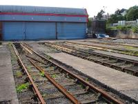 The east end of the former six (now five) road Barry steam shed (88C) and yard, now run by Cambrian Transport as a base for the Vale of Glamorgan Steam Railway. Barry (Town) station canopy is visible at a higher level on the right.<br><br>[David Pesterfield&nbsp;30/08/2012]
