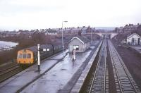 Scene at Haltwhistle station on a rainy morning in 1975 looking west towards Carlisle. A 2-car DMU has recently arrived with a service off the Alston branch.<br><br>[Ian Dinmore&nbsp;//1975]