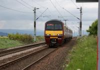 Looking west from Geilston level crossing near Cardross as 320321 approaches during the early evening of 29 May 2010 on a Helensburgh to Airdrie service.<br><br>[John McIntyre&nbsp;29/05/2010]