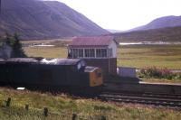 A Class 40 struggles up the hill past Dalnaspidal box in 1977. When local stations between Perth and Inverness were closed in 1965, it was a condition of closure that the Dalnaspidal platforms were retained in case of emergency needs when the A9 was blocked by snow. It is not known if the station was ever subsequently used in emergency, or whether the condition is still in force - but the platforms are still there! [See image 26748]<br><br>[Frank Spaven Collection (Courtesy David Spaven)&nbsp;//1977]