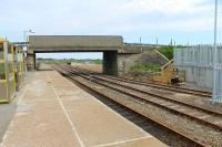 Georgemas Junction, looking towards Wick, on 6th July 2012. The new Dounreay flask loading facility is nearing completion beyond the bridge and to the right. The wagon in the siding was a bogie timber carrier and seemed to be in good (shiny) order but it was unclear if this was a <I>cripple</I> or in use for gauging etc in the new terminal. <br><br>[Mark Bartlett&nbsp;06/07/2012]