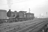 Activity at the north end of Heaton yard in the sixties. The locomotive is J27 0-6-0 no 65831, which spent all its BR years at North Blyth until eventual withdrawal in February 1966. Note the Wills cigarette factory in the background on the other side of the Coast Road.<br><br>[K A Gray&nbsp;//]