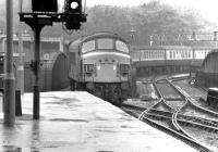 An afternoon arrival at St Pancras during a shower of rain in early September 1969 behind a <I>Peak</I> Type 4 locomotive.<br><br>[John Furnevel&nbsp;05/09/1969]