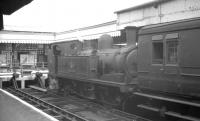 Adams 0-4-4T no 30 <I>Shorwell</I> simmers at the buffer stops at Ryde Pier Head station in the summer of 1961.<br><br>[K A Gray&nbsp;16/08/1961]