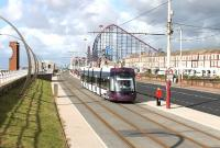 Heading for the southern terminus at Starr Gate <I>Flexity</I> No. 008 leaves the Pleasure Beach behind and runs along the refurbished tramway. This section of the Blackpool sea wall has a number of different scupltures, some of which can be seen in this view.<br><br>[Mark Bartlett&nbsp;11/09/2012]