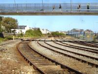 Redundant sidings at the west end of the ecs stabling area at Holyhead in September 2012. Alongside on the left is the longer wash plant run through line. The new footbridge links the Stena terminal and west end of platform 1 with the town's main shopping area. [See image 40291] <br><br>[David Pesterfield&nbsp;05/09/2012]