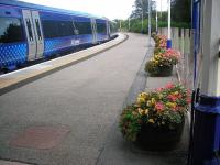 <I>'Forres in Bloom'</I> does a beautiful job in making the surviving platform at Forres extend a floral welcome for visitors to the Morayshire town. View east on 11 September 2012. <br><br>[John Yellowlees&nbsp;11/09/2012]