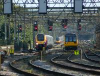 A northbound Voyager and a Class 142 crossing the River Ribble bridge together on the southern approach to Preston station on 5 September 2012. Between them in the distance is a southbound Pendolino making for its next port of call at Wigan North Western.<br><br>[John McIntyre&nbsp;05/09/2012]