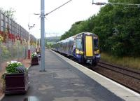 The 11.53 Largs - Glasgow Central runs into the attractively decorated platform at West Kilbride on 12 September.<br><br>[Colin Miller&nbsp;12/09/2012]