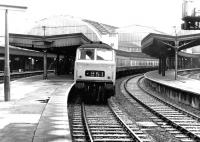An afternoon semi-fast service to Worcester and Hereford prepares to leave Paddington station in May 1969 behind an unidentified <I>'Hymek'</I> diesel-hydraulic locomotive.<br><br>[John Furnevel&nbsp;05/05/1969]