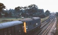 Electro-diesel E6015 heads west approaching Brockenhurst with a parcels train on a late July evening in 1971.<br><br>[John McIntyre&nbsp;/07/1971]