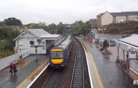 A dreich day in Fife on 20 September 2012, as the 12.33 departure for Edinburgh Waverley restarts its journey south from Inverkeithing station.<br><br>[Andrew Wilson&nbsp;20/09/2012]