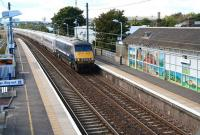 The 13.30 ex-Waverley speeds through Prestonpans station on 19 September 2012 on its 4 hour 26 minute journey to Kings Cross. The train is about to run past the impressive mural created by artist Adele Conn a year earlier [see image 4963].<br><br>[John Furnevel&nbsp;19/09/2012]