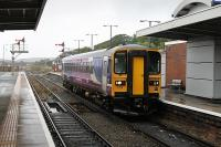 153315 arrives in Barrow on a very wet morning, clearing the single line section from Askam for a Carlisle service to go forward. Just beyond the platform end the refuelling and stabling point (BW) is still in use, albeit empty during the daytime. <br><br>[Mark Bartlett&nbsp;20/09/2012]
