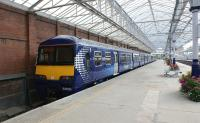 Waiting for work. A pair of Class 320 EMUs in ScotRail blue, stabled in platform 3 (onetime platform 4) at Helensburgh Central on 23 September 2012.<br><br>[John McIntyre&nbsp;23/09/2012]