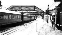 Old photograph, thought to have been taken in the late 1940s, showing a winter scene at Town Green station, Aughton, Lancs. Nowadays this station is part of the Ormskirk branch of Merseyrail's Northern Line. [See image 19649]<br><br>[John McIntyre Collection&nbsp;//]