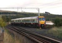 During the early evening of 22 September 2012, a train bound for Helensburgh Central slows for the stop at Craigendoran, shortly after passing the junction with the West Highland Line. <br><br>[John McIntyre&nbsp;22/09/2012]