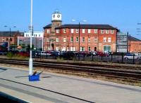 The entrance building is one of the few remaining parts of the Midland's Derby Works, and one of the few which can be seen from the station. The building, seen here in September 2012, has been renovated and updated with modern extras: truly 'old meets new'. Notice the high-tech wash equipment on the platform.<br><br>[Ken Strachan&nbsp;15/09/2012]